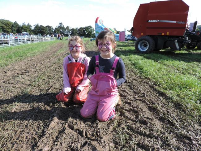 MUCKY PUPS Hannah Renwick, Blackhouse, and Belle Hume, Sundhope, enjoying the mud at Yarrow Show last year