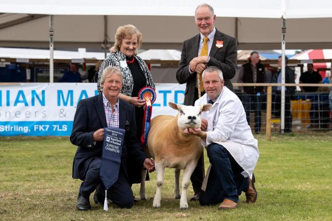 Texel champion from Douganhill  farms stood overall sheep inter-breed champion,Brian and David MacTaggart with sponsor Margaret Barbour and judge Archie MacGregor   Ref:RH220619143    Rob Haining / The Scottish Farmer