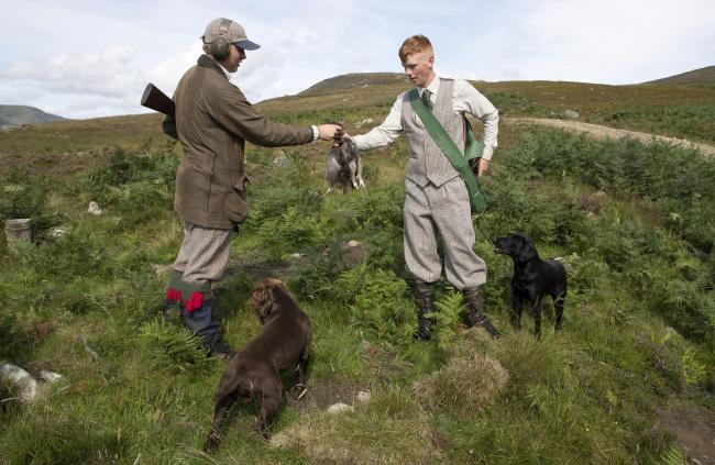 Archie Ward (left) with gamekeeper Jack Turner (right), shot the first brace of the day on Rottal Moor in the Angus Glens on the opening day of the season (PC: Perthshire Picture Agency)