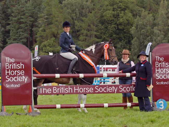 Jade Paterson won the BHS Scotland/Clemmie Scottish Style Jumping championships at Blair in August, pictured here with Pam Dykes form the sponsors and Gail Smith who was the judge. Picture by  Julia Shearwood Photography