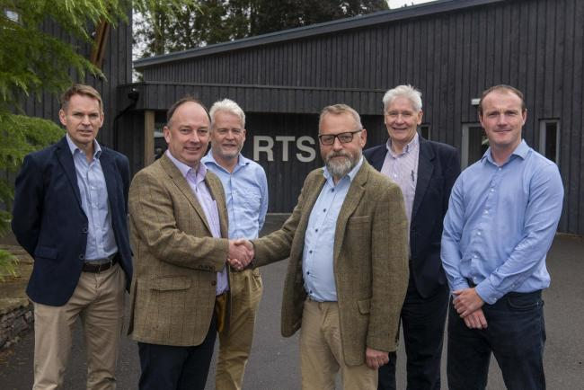 HAND OVER from left, EGGER Forestry development manager Simon Hart, RTS managing director Norman O'Neill, director Harry Wilson, EGGER director John Paterson, RTS chairman Alan Robbins and RTS director Ross Kennedy
