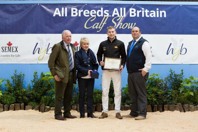 Phil Potts receives his award from John and Sarah Hartley at the All Breeds All Britain Calf Show