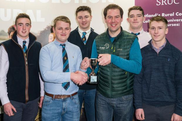 Scott Campbell (third from right) presents the 2019 Winter Wheat Challenge to (L-R) Gregor Service, Conner McCaig, Charlie Fullarton, Allan Ferrie and Gareth Hall at AgriScot