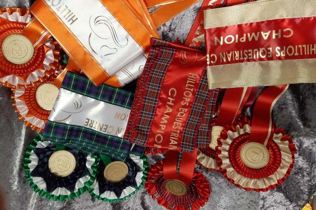 All types of rosettes and sashes are hand-sewn to order