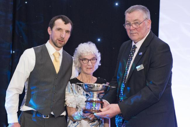 Jim Innes's wife, Jan and his son James, were presented with the Miskelly Award by NFU Scotland president Andrew McCornick