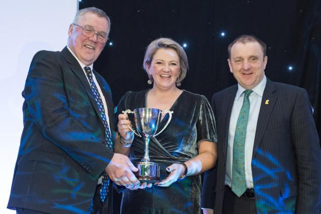 TRACEY ROAN collecting the Ambassador award from president Andrew McCornick (left) and NFU Mutual chairman Jim McLaren