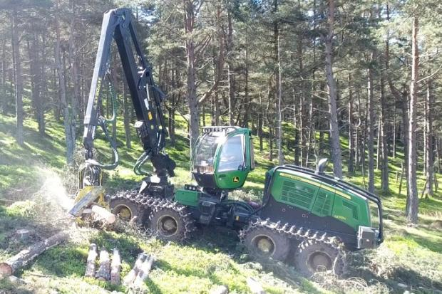 The John Deere harvester can make the best use of timber by using its on-board computer