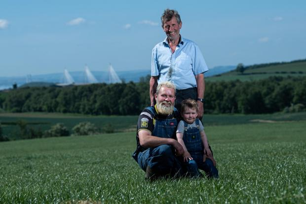 Brian Weatherup, son Brian and grandson Hunter (2) from Parkend, Crossgates, Fife are hoping enough rain will fall to wash in the slurry and fertiliser to boost a second silage crop  Ref:RH0106200077  Rob Haining / The Scottish Farmer...