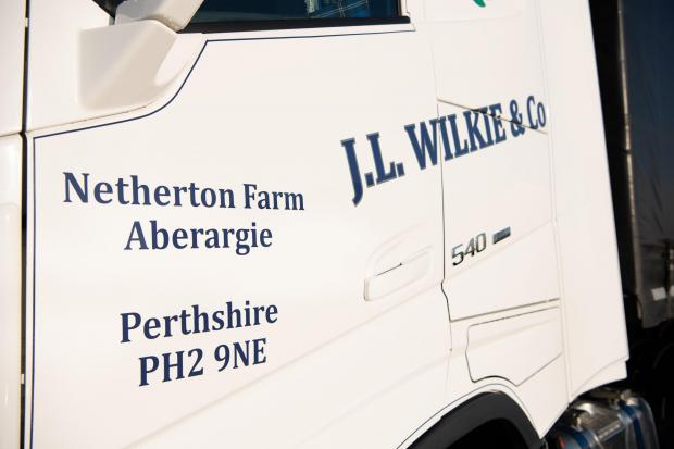 The Scottish Farmer: all trucks are branded and the sign writing stand out on the white tractor units Ref:RH281120136 Rob Haining / The Scottish Farmer...