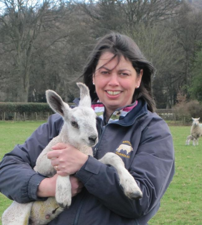 Kay Adam at home with one of the Bluefaced Leicester lambs