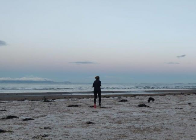 Gayle Glendinning from Team Scotland, racking up miles for run1000 on Ayr beach with dog Finn, in support of RSABI