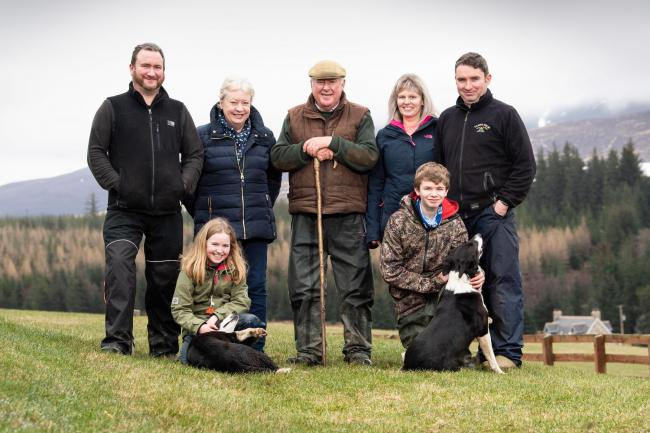 Shearer Family (L-R) Neil, Anne, John, Louise, Gavin with Ellie(10) and Alex(14) at the front with working dogs Tess and Skye   Ref:RH19032187  Rob Haining / The Scottish Farmer...