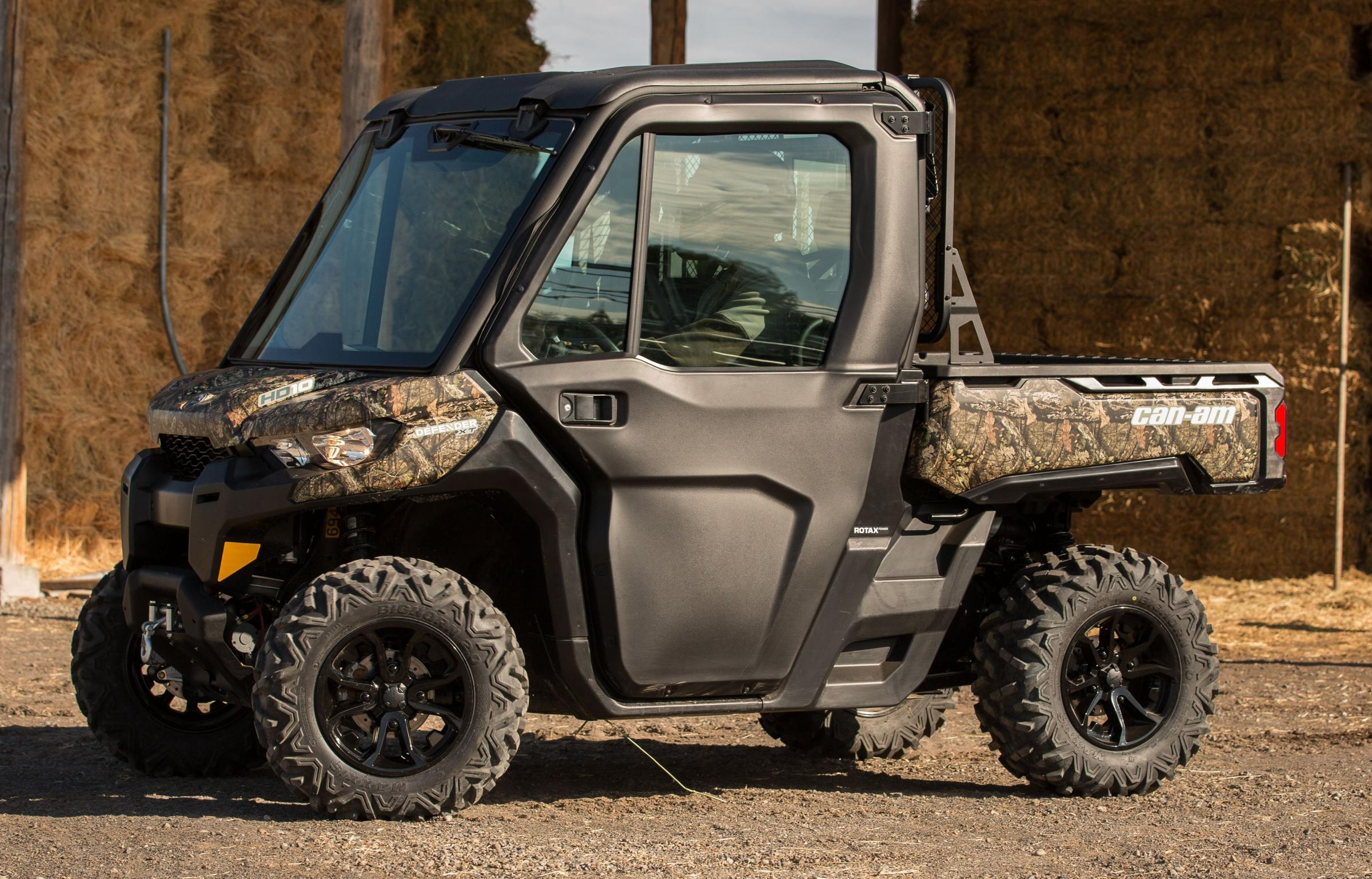 CAN-AM'S Defender XT with full-on cab and camo paintwork