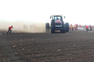 Support staff race to keep the seed and fertiliser drill topped up during the record drilling attempt