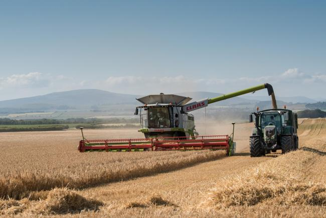 MAKING THE most of the stunning weather that Scotland had on Tuesday were John Grant on the combine and James Hopkinson in the tractor, busy harvesting the barley crop near Kinnettles, Angus  Ref:RH18717420