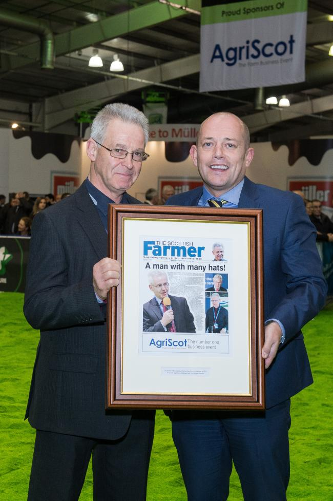 Andrew Moir is stepping down as Agriscot Chairman and Scottish Farmer Publisher Darren Bruce is presenting him with a framed gift  Ref:RH1511170198