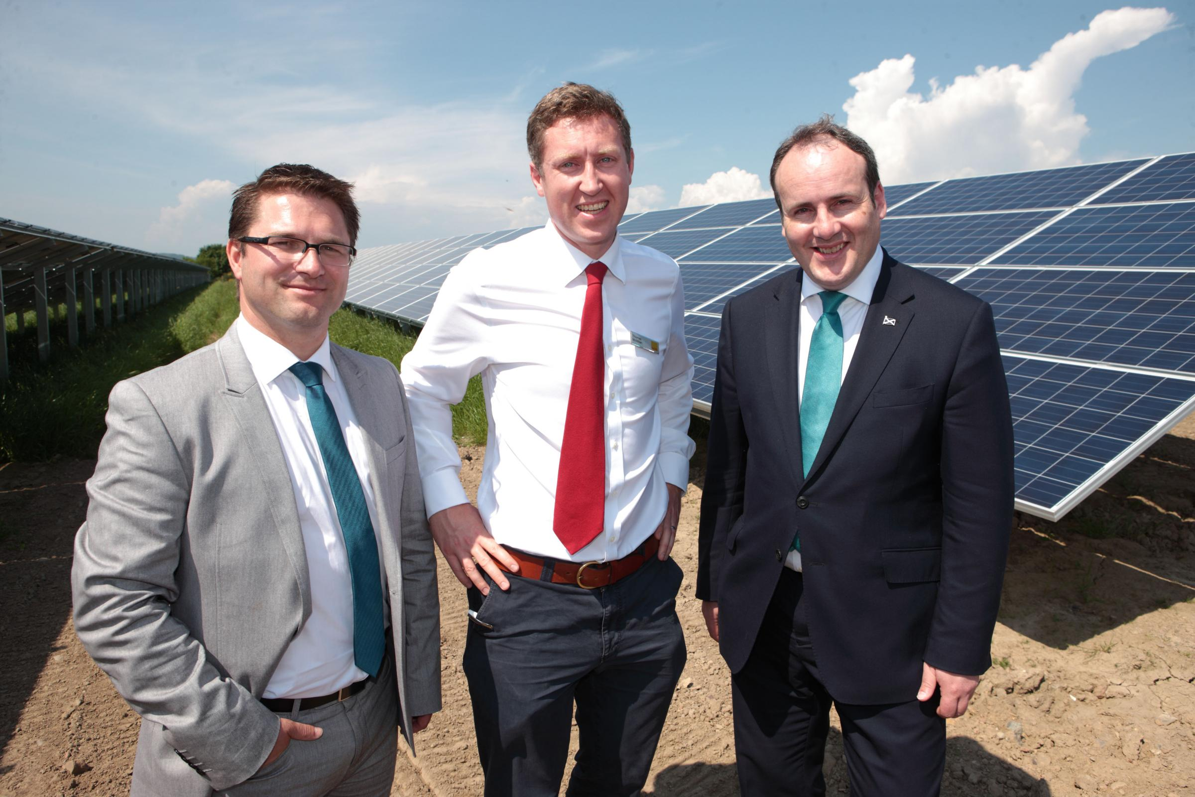 SUNSHINE BOYS Thomas McMillan (centre) and Scottish energy minister Paul Wheelhouse (right), at the opening of the Errol Estates solar farm by Chris Kopak of Canadian Solar (left)