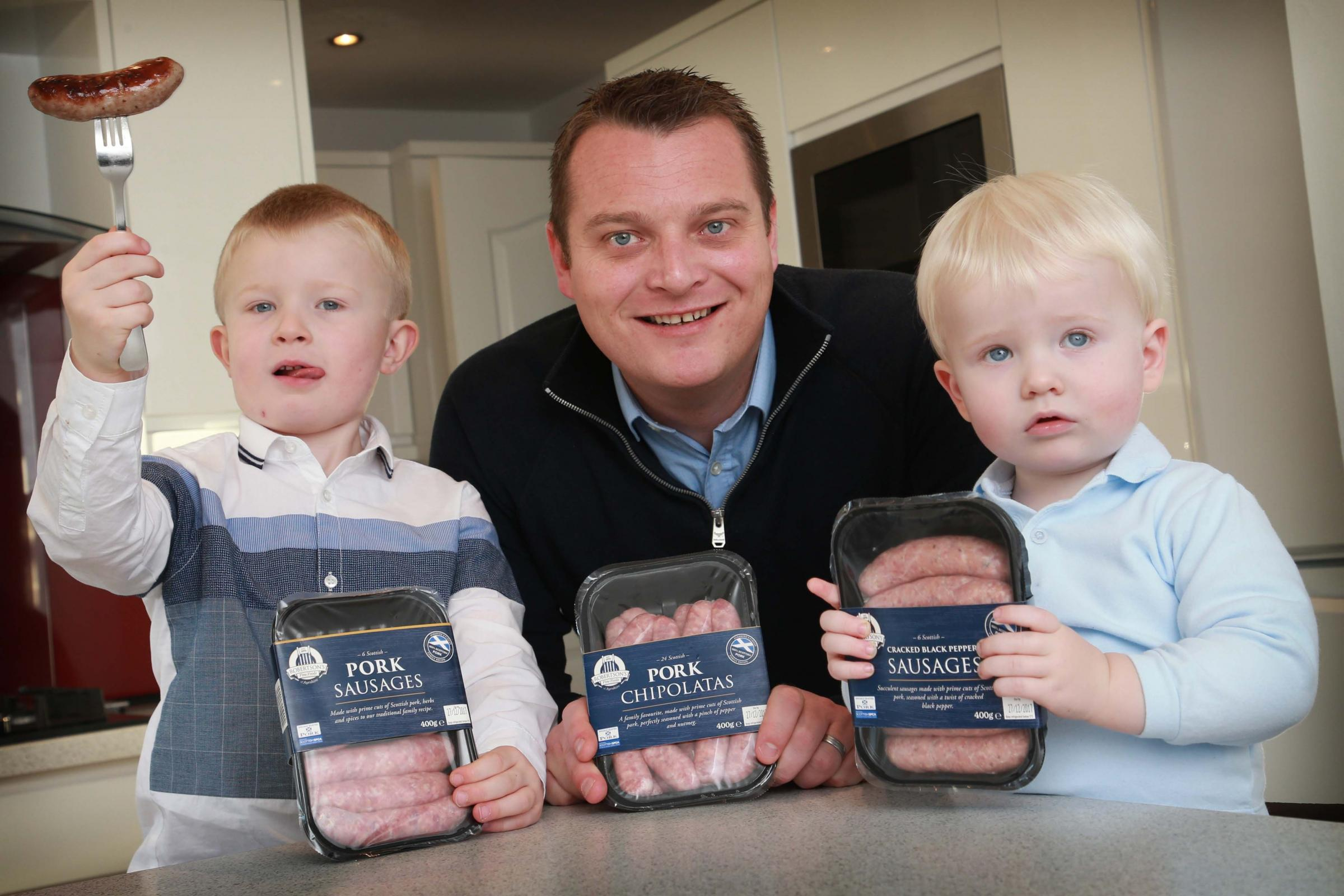 Lewis Robertson, Barry Robertson and Cameron Robertson, road test the family firm's new sausages at their home in Ayrshire