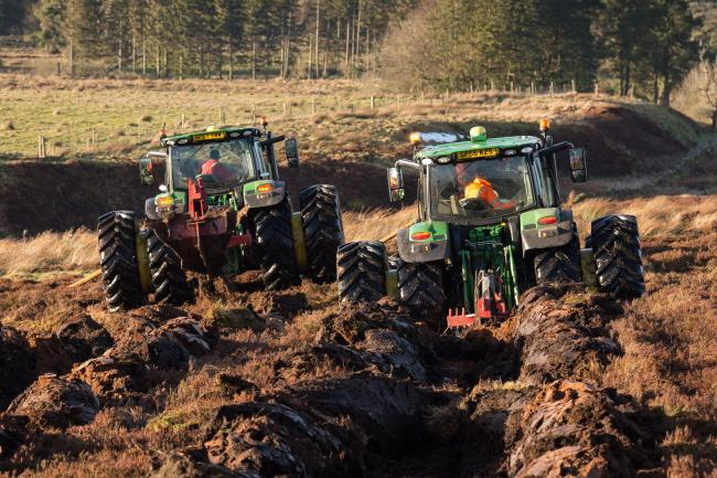 Scott Dalgleish and James Muir ploughing the 200 acre hillside above Sheriffmuir near Dunblane, ready for tree planting, using GPS-equipped John Deeres from Arbuckle Contracting, based at Hill Of Kinnaird Farm, near Falkirk Ref:RH240118084