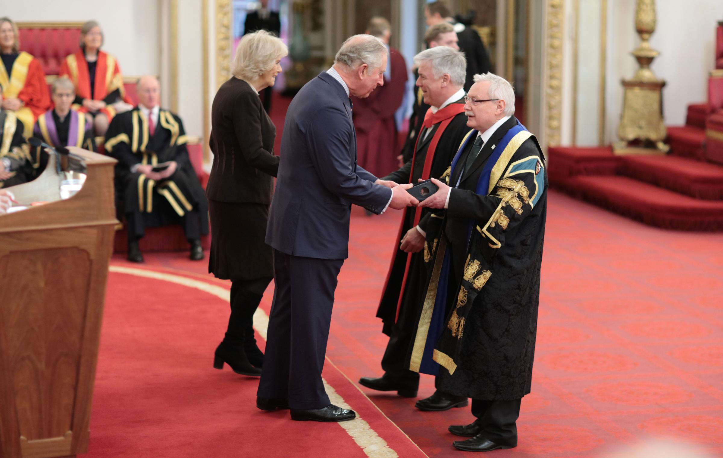 PRINCE CHARLES presents the principal and chief executive of Scotland's Rural College, Wayne Powell, with the SRUC's Queen's Anniversary Prize, while SRUC Professor Mike Coffey collects the scroll from Camilla, Duchess of Cornwall, at Buckingham P