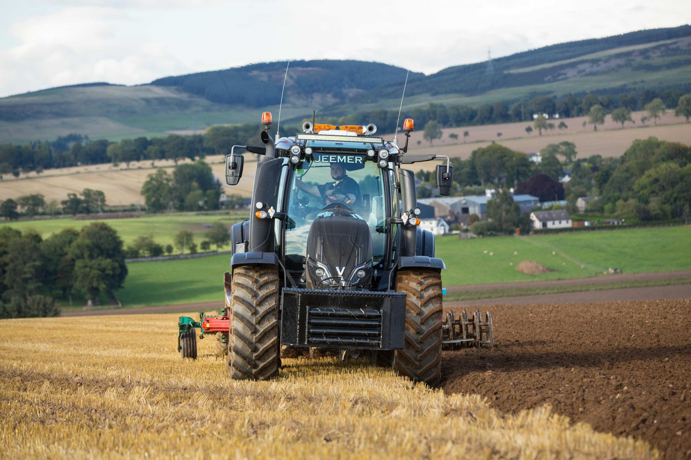 Hard at work the black T174 Valtra ploughing in spring oat stubble with a five furrow Kvernland and Lemkin press to prepare for next year's winter wheat crop at West Adamston Farm, Dundee.  Ref:EC0609183608