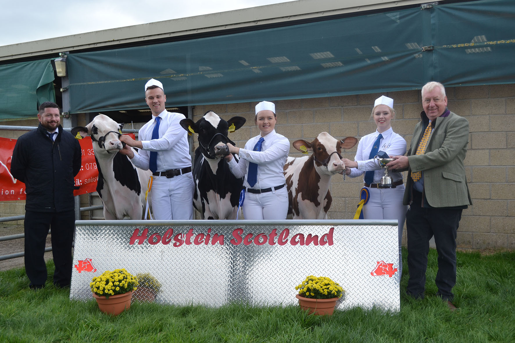 Calf winners from left judge Steve McLoughlan, Neil Sloan, Zoe Bryson, Alison Hunter and sponsor Archie Leitch