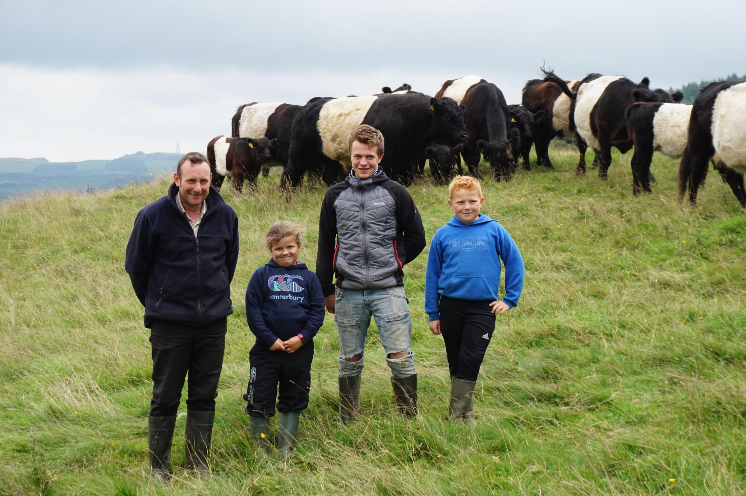 Speddoch Farm Partnership won the best overall herd at the biannual Scottish Belted Galloway Club awards. Pictured (L-R) stockman Robert Ross, Caitlyn Ross, Hayden Ross and Calum Ross