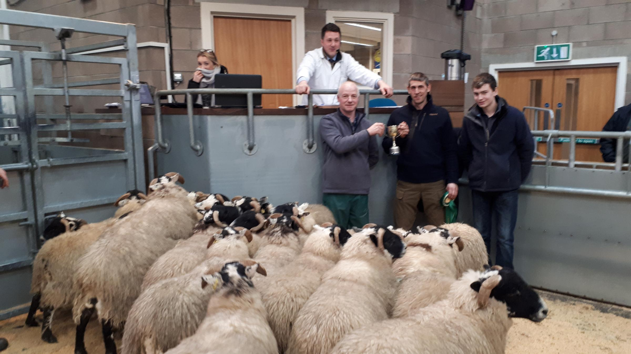 Champion pen of Blackfaces from DH Amory, Glenfernate, pictured with Andrew Argo (judge) who later purchased the pen for £80 per head and farm manager, Ross McIntosh and John Harvie, shepherd