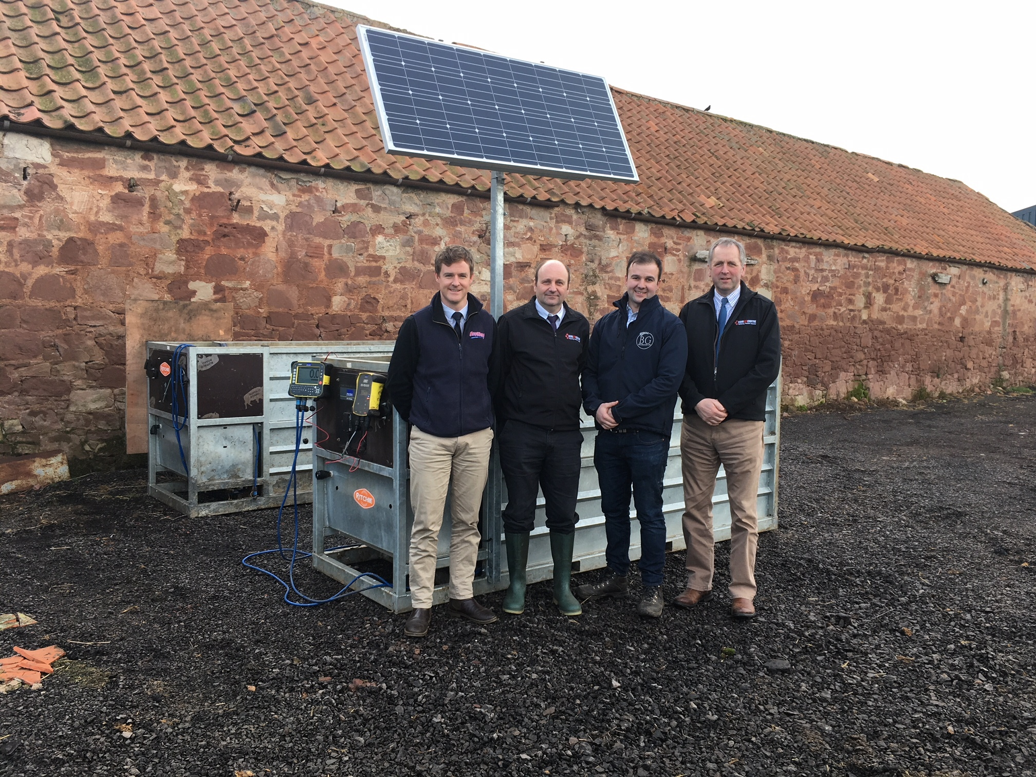Willie Rowe, Scotbeef (Bielgrange's supply chain partne) left to Dave Ross, Agri-EPI; Niall Jeffrey, Bielgrange Farm; Gavin Dick, Agri-EPI in front of one of the Beef Monitors