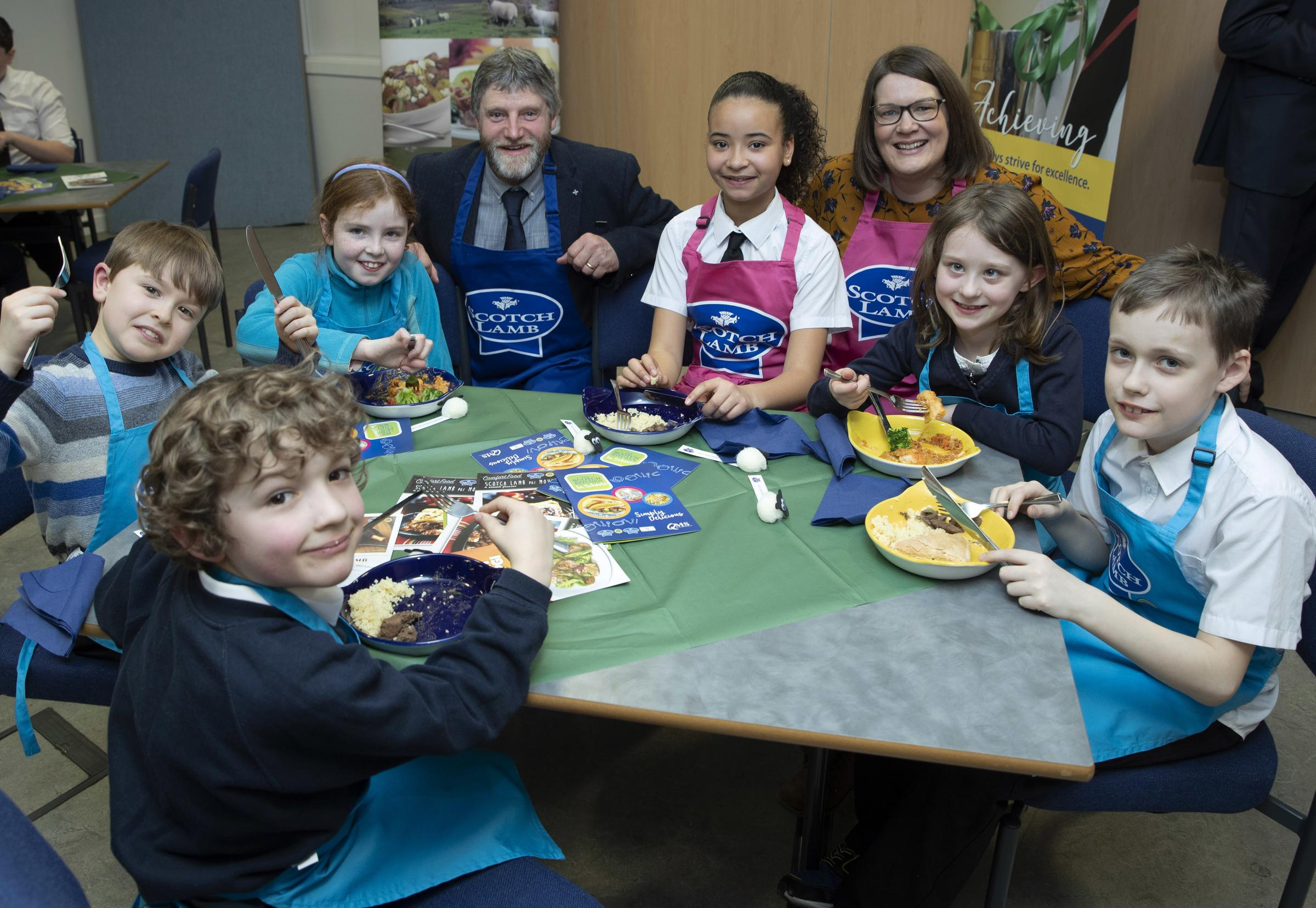 Martin Kennedy from NFUS and Jen Robertson from QMS with pupils sampling the Scotch Lamb school menu (Photo: Perthshire Picture Agency)
