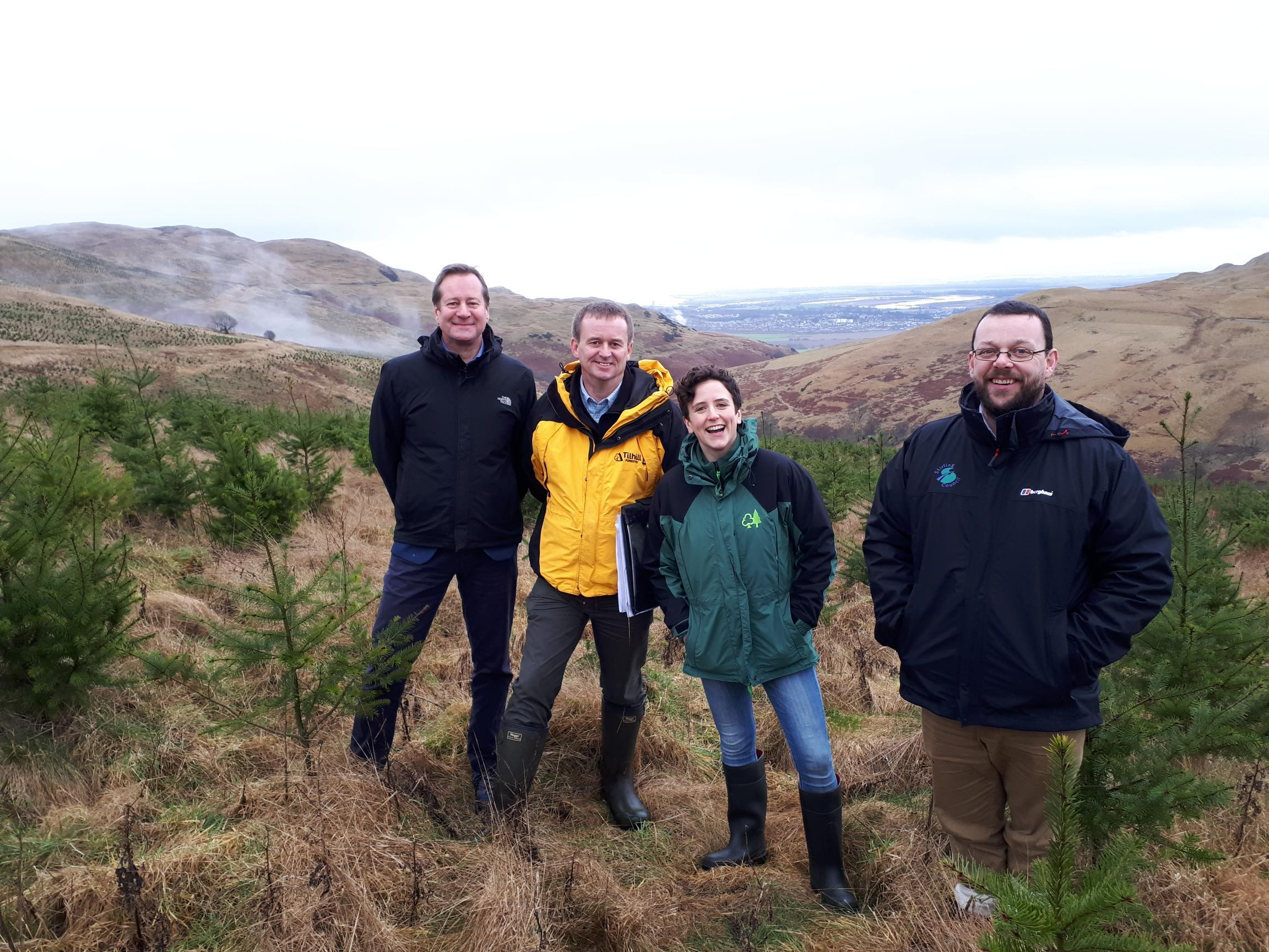 MINISTER for Rural Affairs and the Natural Environment, Mairi Gougeon, centre, flanked by Confor chief executive Stuart Goodall and Tilhill district manager Andrew Vaughan (left) and Stirling Council archaeologist Murray Cook (right)