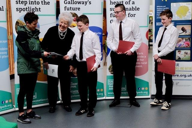 "Douglas Ewart pupils hand over to the Minister a copy of ""It's our time"" setting out the case for a National park in Galloway"