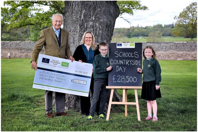 On behalf of the Fallago Environment Fund, His Grace, The Duke of Roxburghe joins Border Union Agricultural Society (BUAS) Executive Director, Mags Clark plus Max Lee and Shannon Cruddas from Yetholm Primary to announce a £28,500 grant from the Fund